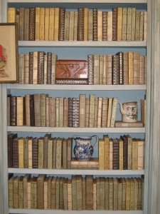 These antique leather bound books are amazing!! This neutral palette of green, blue and ivory is so chic.  What an elegant way to accessorize a bookshelf in any room! I can't wait to use them...